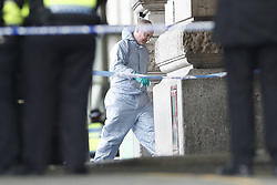 © Licensed to London News Pictures. 05/03/2019. London, UK. A police officer in protective clothing is seen at Waterloo Station as police deal with a suspicious package. Earlier reports said the station has been evacuated, but police state that trains are running as normal. Similar incidents have been reported at Heathrow and London City airport. Photo credit: Peter Macdiarmid/LNP