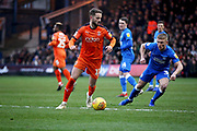 Luton Town midfielder Andrew Shinnie (11) watch by Peterborough Utd's Kyle Dempsey (30) during the EFL Sky Bet League 1 match between Luton Town and Peterborough United at Kenilworth Road, Luton, England on 19 January 2019.