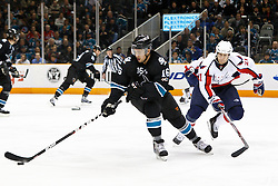 February 17, 2011; San Jose, CA, USA;  San Jose Sharks right wing Devin Setoguchi (16) skates with the puck past Washington Capitals center Brooks Laich (21) during the first period at HP Pavilion.  San Jose defeated Washington 3-2. Mandatory Credit: Jason O. Watson / US PRESSWIRE