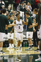 17 December 2011:  Eliud Gonzalez during an NCAA mens division 3 basketball game between the Washington University Bears and the Illinois Wesleyan Titans in Shirk Center, Bloomington IL