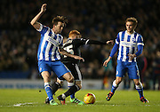 Brighton central midfielder, Dale Stephens (6), Brighton striker (on loan from Manchester United), James Wilson (21), Brentford midfielder Ryan Woods during the Sky Bet Championship match between Brighton and Hove Albion and Brentford at the American Express Community Stadium, Brighton and Hove, England on 5 February 2016.