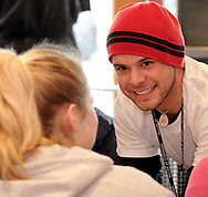 Joe Melendrez (right) talks to U.D. Sophomore Trish Graham at a burrito party for the homeless hosted by U.D. Religious Studies student Joe Melendrez at Chipotle's on Brown Street in Dayton.