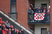 Orient fans with an apartment view during the Sky Bet League 2 match between Leyton Orient and Oxford United at the Matchroom Stadium, London, England on 17 October 2015. Photo by Bennett Dean.