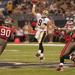 2008 September 7: Drew Brees (9) of the New Orleans Saints throws a pass as Tampa Bay Buccaneers defensive end Gaines Adams (90) provides pressure during their game at the Louisiana Superdome in New Orleans, LA.  The New Orleans Saints (1-0) defeated the Tampa Bay Buccaneers (0-1) 24-20.
