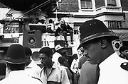 Police in front of a sound system, Notting Hill Carnival, London, UK, 1983