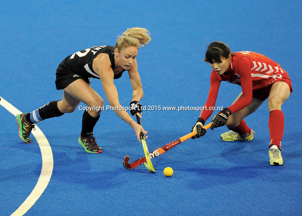 New Zealand Black Stick Anita Punt and Koreas Yoo Jin Hong in action in the Festival of Hockey, New Zealand Womens Black Sticks v Korea, Unison Sports Park, Hastings, Saturday, April 118 2015. Photo: Kerry Marshall / photosport.co.nz