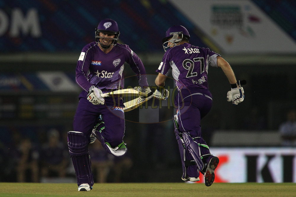 Ben DUNK of the Hobart Hurricanes  and Tim PAINE (Captain) of the Hobart Hurricanes  during match 2 of the Oppo Champions League Twenty20 between the Kings XI Punjab and the Hobart Hurricanes held at the Punjab Cricket Association Stadium, Mohali, India on the 18th September 2014<br /> <br /> Photo by:  Ron Gaunt / Sportzpics/ CLT20<br /> <br /> <br /> Image use is subject to the terms and conditions as laid out by the BCCI/ CLT20.  The terms and conditions can be downloaded here:<br /> <br /> http://sportzpics.photoshelter.com/gallery/CLT20-Image-Terms-and-Conditions-2014/G0000IfNJn535VPU/C0000QhhKadWcjYs