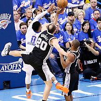 06 May 2016: Oklahoma City Thunder guard Russell Westbrook (0) goes for the jump shot past San Antonio Spurs guard Manu Ginobili (20) during the San Antonio Spurs 100-96 victory over the Oklahoma City Thunder, during Game Three of the Western Conference Semifinals of the NBA Playoffs at the Chesapeake Energy Arena, Oklahoma City, Oklahoma, USA.