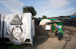 © Licensed to London News Pictures. 30/08/2015. Calais, France. The school at the refugee camp in Calais, also known as the Jungle, where people take lessons in French and English. Tomorrow the French PM, Manuel Valls, will visit the day centre Jules Ferry at the camp. Photo credit : Isabel Infantes/LNP
