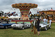 © Licensed to London News Pictures. 16/09/2012. Goodwood, UK . A traditional fun fair ride. People enjoy the atmosphere at the 2012 Goodwood Revival. The event recreates the glorious days of motor racing and participants are encouraged to dress in period dress. Photo credit : Stephen Simpson/LNP