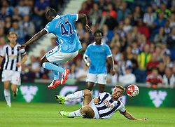 WEST BROMWICH, ENGLAND - Monday, August 10, 2015: West Bromwich Albion's James Morrison tackles Manchester City's Yaya Toure during the Premier League match at the Hawthorns. (Pic by David Rawcliffe/Propaganda)