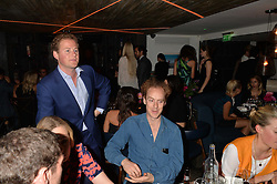 Left to right, GUY PELLY and TOM INSKIP at the launch of Geisha at Ramusake hosted by Piers Adam and Marc Burton at Ramusake, 92B Old Brompton Road, London on 11th June 2015.