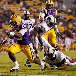 November 13, 2010; Baton Rouge, LA, USA; LSU Tigers running back Spencer Ware (16) runs for a touchdown during the second  half against the Louisiana Monroe Warhawks at Tiger Stadium. LSU defeated Louisiana-Monroe 51-0.  Mandatory Credit: Derick E. Hingle