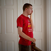 ROCKVILLE, MD - JUL25: John Bucknam, 18, who has autism, wears a shirt to sleep in only which alerts people to the fact that he has autism if he is found alone and to call 911, July 25, 2014 in Rockville, MD. The Bucknam's have a series of locks on their doors to keep John from wandering off. (Photo by Evelyn Hockstein/For The Washington Post)