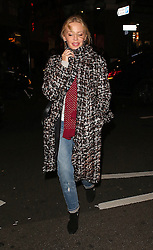 (EXCLUSIVE PICTURES) Singer Kylie Minogue wearing her huge engagement ring, check coat, polka-dot scarf, ripped jeans and a pair of black boot attends a screening of La La Land at the Picturehouse Central in London, UK. 15/12/2016<br />
