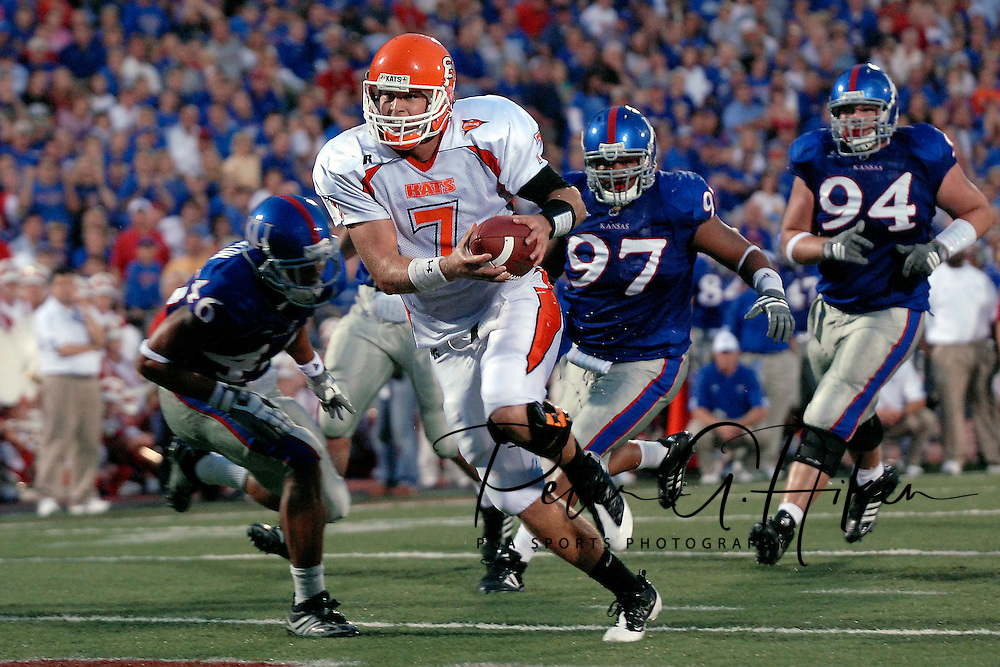 Sept 20, 2008; Lawrence, KS, USA; Sam Houston State Bearkats quarterback Rhett Bomar (7) rushes 8 yards for a touchdown past Kansas Jayhawks defenders Richard Johnson (97) and Caleb Blakesley (94) during the second quarter at Memorial Stadium.