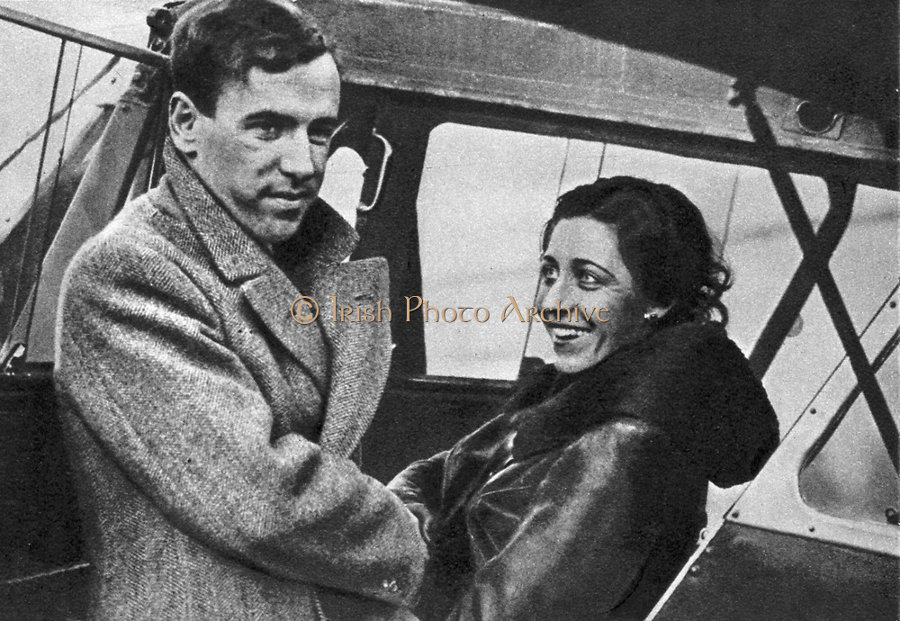 Amy Johnson (1903-1941) English aviator, about to set out for Cape Town 1932. Johnson  saying goodbye to her husband, fellow pilot James Mollison, before starting off.  She created a new record for a solo flight from London to Cape Town, completing the trip in 4 days, 6 hours and 54 minutes, beating her husband's record by 10 hours, 28 minutes.