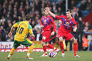 London - Tuesday, January 1st, 2008: Mark Hudson (R) of Crystal Palace and Jamie Cureton (L) of Norwich City as Sean Derry (C) looks on during the Coca Cola Championship match at Selhurst Park, London. (Pic by Mark Chapman/Focus Images)