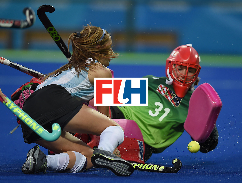 USA goalkeeper Jackie Briggs blocks Argentina's Carla Rebecchi during the women's field hockey Argentina vs USA match of the Rio 2016 Olympics Games at the Olympic Hockey Centre in Rio de Janeiro on August, 6 2016. / AFP / MANAN VATSYAYANA        (Photo credit should read MANAN VATSYAYANA/AFP/Getty Images)