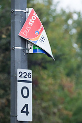 © Licensed to London News Pictures . 25/09/2013 . Brighton , UK . A melted bus stop sign by where the bus caught fire . The burned out remains of a Brighton-bound bus that caught fire minutes before the firefighters strike had ended , on the A23 this afternoon (25th September 2013) . The smoke filled road was closed to traffic causing large tailbacks . Photo credit : Joel Goodman/LNP