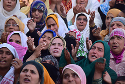 April 14, 2018 - Srinagar, Kashmir, India - Kashmiri Women crying while beseech for blessings as the Holy Relic, Believed to be a hair from the beard of Prophet Mohammed PBUH is being displayed by Holy Priest on a balcony during the occasion of Mehraj-ul-Nabi at Hazratbal shrine in Srinagar. (Credit Image: © Abbas Idrees/SOPA Images via ZUMA Wire)
