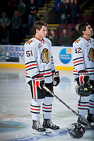 KELOWNA, CANADA - OCTOBER 4:  Derrick Pouliot #51 of the Portland Winterhawks stands on the ice during the national anthem  at the Kelowna Rockets on October 4, 2013 at Prospera Place in Kelowna, British Columbia, Canada (Photo by Marissa Baecker/Shoot the Breeze) *** Local Caption ***