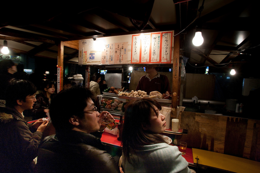 Yatai in  fukuoka.along the canal in the  Hakata ward of Fukuoka  yatai stalls serving a wide verity of foods from the  ubiquitous Ramen to tempura,  grIilled meats and fish to even french cuisine,  Japanese street food stands were popularized in the 19th Century  After World War II, yatai exploded as  cheap food and an inexpensive enterprise for survivors and war widows. Within a decade of the war's conclusion, The city is now the last stand for the street food culture of Japan