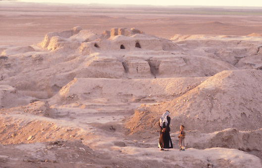 Iraqi father and son in Sumerian ruins of Uruk in Southern Iraq
