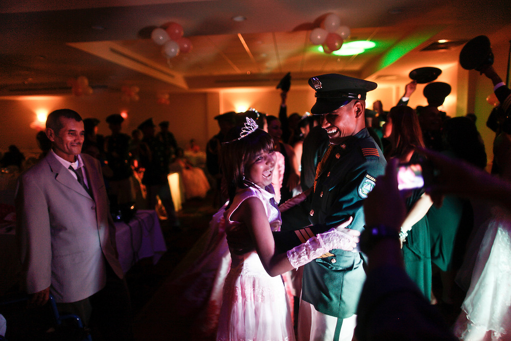 In this photo taken on Saturday, Aug. 27, 2011. A leukemia patient Maria Jose Martinez, fourteen  years old dances with a cadet during the 'Quinceanera' celebration at the hotel in Managua, Nicaragua. Maria Jose was admitted for her Treatment at La Mascota Hospital in May. 10 of 2011 until August. 29 of 2011, during that period she stayed one month at the intensive care unit. The Association of Parents of children with leukemia and Cancer in Nicaragua, Mapanica, have been organizing for their third year the 15 year old celebration of young girls that have been struggling with the cancer and they still are battling to win this fight against some type of cancer and leukemia at the Childrens hospital La Mascota, in Managua, Nicaragua.