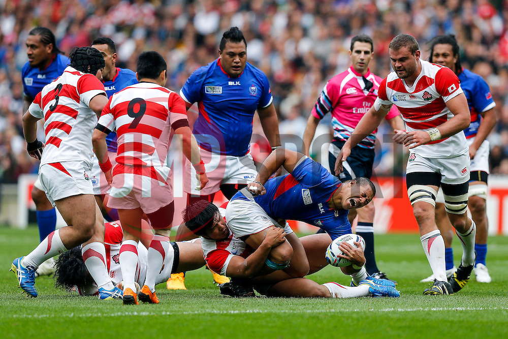 Samoa Outside Centre Paul Perez is tackled - Mandatory byline: Rogan Thomson/JMP - 07966 386802 - 03/10/2015 - RUGBY UNION - Stadium:mk - Milton Keynes, England - Samoa v Japan - Rugby World Cup 2015 Pool B.
