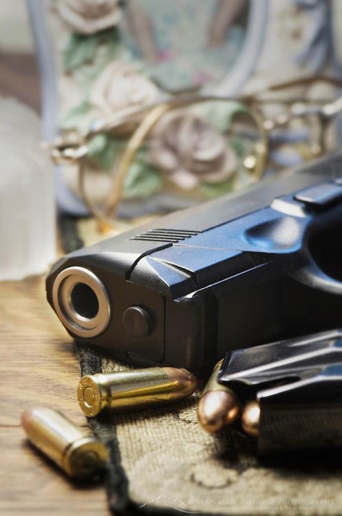 Beretta 9mm PX4 Storm semi-automatic pistol on bedside nightstand