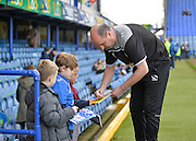 Portsmouth Manager Paul Cook signs the match programme during the Sky Bet League 2 match between Portsmouth and Newport County at Fratton Park, Portsmouth, England on 12 March 2016. Photo by Adam Rivers.
