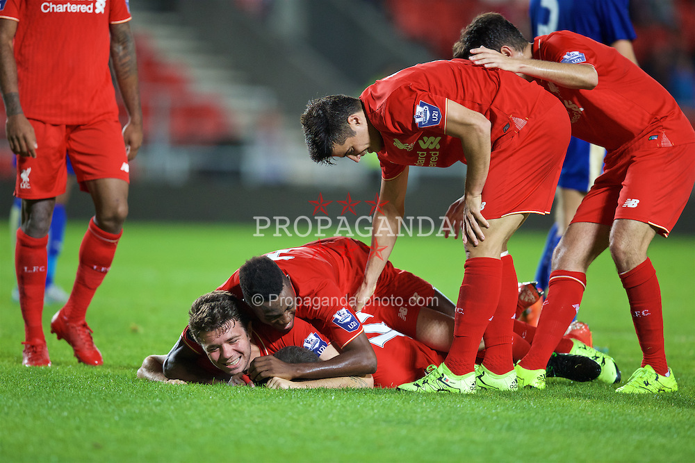 ST HELENS, ENGLAND - Monday, September 28, 2015: Liverpool's Cameron Brannagan [hidden below] celebrates scoring the second goal against Leicester City with team-mate Joe Maguire, Madger Gomes and Joao Carlos Teixeira during the Under 21 FA Premier League match at Langtree Park. (Pic by David Rawcliffe/Propaganda)
