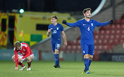 WREXHAM, WALES - Thursday, November 10, 2016: Wales players dejected at full time against Greece after the UEFA European Under-19 Championship Qualifying Round Group 6 match at the Racecourse Ground. (Pic by Gavin Trafford/Propaganda)