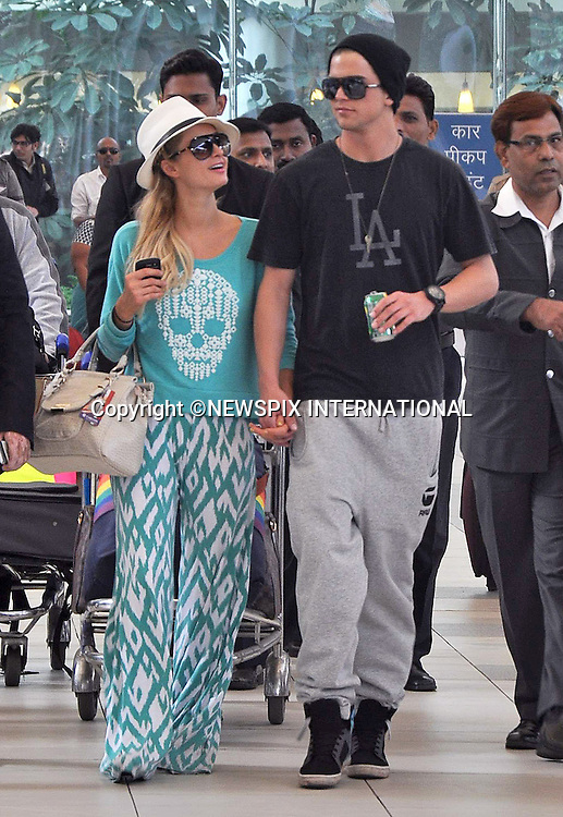 "03.12.2012; Mumbai, India: PARIS HILTON AND RIVER VIIPERI.arrive at Mumbai Airport, after spending the weekend in Goa..The American heiress and socialite took to the catwalk and acted as DJ at the closing of the annual Fashion Show held on Candolim Beach, Goa.Mandatory Photo Credit: ©Bhayani/NEWSPIX INTERNATIONAL..**ALL FEES PAYABLE TO: ""NEWSPIX INTERNATIONAL""**..PHOTO CREDIT MANDATORY!!: NEWSPIX INTERNATIONAL(Failure to credit will incur a surcharge of 100% of reproduction fees)..IMMEDIATE CONFIRMATION OF USAGE REQUIRED:.Newspix International, 31 Chinnery Hill, Bishop's Stortford, ENGLAND CM23 3PS.Tel:+441279 324672  ; Fax: +441279656877.Mobile:  0777568 1153.e-mail: info@newspixinternational.co.uk"
