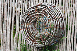 A cray pot hangs on a fence at a cottage near Bicheno on the east coast of Tasmania.