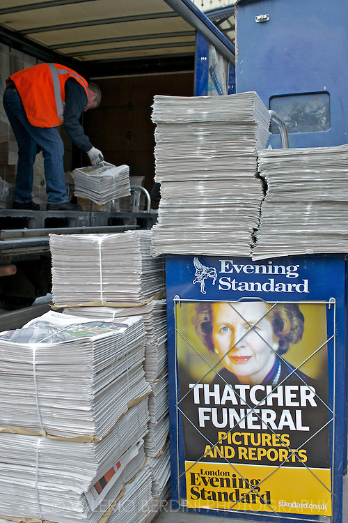 Evening Standard's worker delivers free copies of the newspaper issue covering Margaret Thatcher's funeral in front of Victoria Station in London.