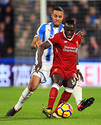 Sadio Mane of Liverpool and Mathias Zanka Jorgensen of Huddersfield Town - Mandatory by-line: Matt McNulty/JMP - 30/01/2018 - FOOTBALL - John Smith's Stadium - Huddersfield, England - Huddersfield Town v Liverpool - Premier League