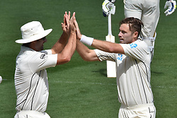 March 26, 2018 - Auckland, Auckland, New Zealand - Tim Southee (R) of Blackcaps is congratulated by teammate taking wicket of Dawid Malan of England during Day Five of the First Test match between New Zealand and England at Eden Park in Auckland on Mar 26, 2018. (Credit Image: © Shirley Kwok/Pacific Press via ZUMA Wire)