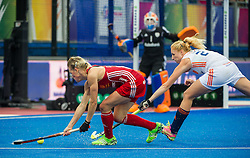 England's Alex Danson shoots while under pressure from Margot van Geffen of The Netherlands. England v The Netherlands - Final Unibet EuroHockey Championships, Lee Valley Hockey & Tennis Centre, London, UK on 30 August 2015. Photo: Simon Parker