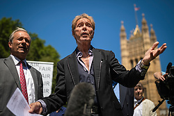 © Licensed to London News Pictures. 01/07/2019. London, UK. Sir Cliff Richard (centre) at the launch of a campaign calling for a ban on naming sex crime suspects unless they have been charged. Photo credit: Rob Pinney/LNP