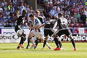 Huddersfield Town midfielder Joe Lolley (18) gets through during the EFL Sky Bet Championship match between Huddersfield Town and Brentford at the John Smiths Stadium, Huddersfield, England on 6 August 2016. Photo by Simon Davies.