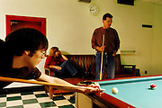 The Snively family, from left, meteorology major Darren, mother Carol, and father Victor, play billards in the Baker Recreation Center Nov. 5, 2005 during Parent's Weekend at Ohio University.