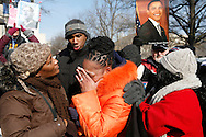 Linda Walker, of Bayshore, New York, (orange jacket) celebrates as an announcement is made that George W. Bush is no longer predident during inaugural ceremonies for Barack Obama.