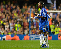 Photo: Daniel Hambury.<br /> Chelsea v Barcelona. UEFA Champions League, Group A. 18/10/2006.<br /> Chelsea's Didier Drogba celebrates as he leaves the pitch.