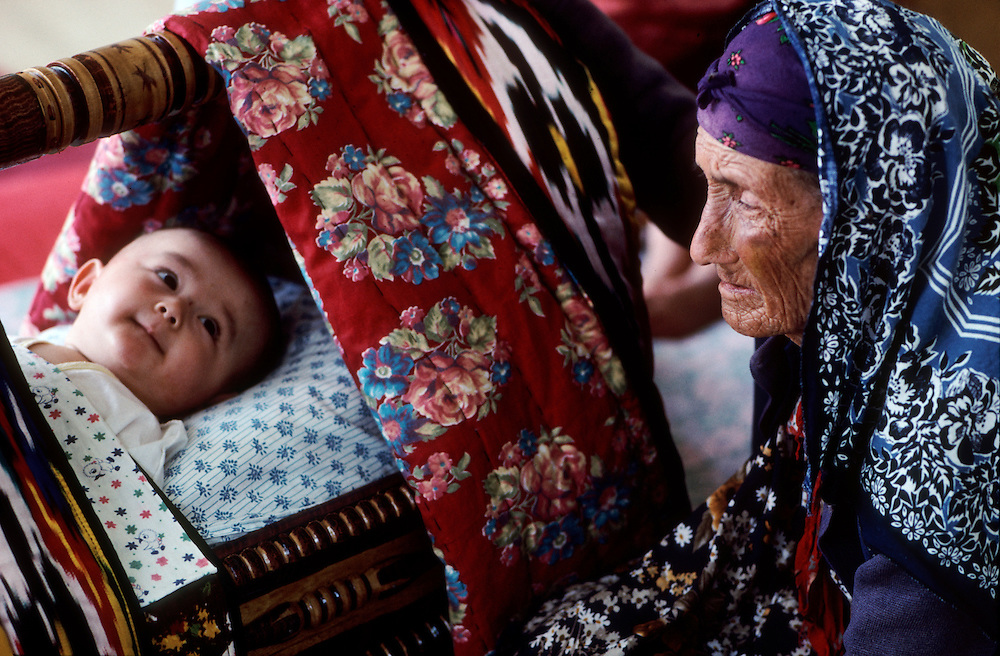 A great grandmother was blind and could not see her great-granddaughter, in Tajikistan.