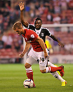 Picture by Richard Land/Focus Images Ltd +44 7713 507003<br /> 27/08/2013<br /> Scott Wiseman of Barnsley and Emmanuel Mayuka of Southampton during the Capital One Cup match at Oakwell, Barnsley.