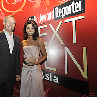 HONG KONG - MARCH 24:  Hollywood Reporter's Senior VP, Publishing Director Eric Mika (L) and Indian actress and former Miss World Priyanka Chopraattend The Hollywood Reporter Next Gen Asia Launch Cocktail Reception event at the W Hotel Kowloon on March 24, 2009 in Hong Kong. The initiative has recognised over 500 individuals under 35 over the last 15 years, and is run in conjunction with the Hong Kong International Film Festival.  Photo by Victor Fraile / studioEAST