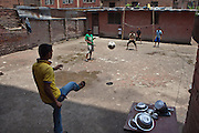 Young Nepalese street-children play football in the back yard of the Voice of Children rehabilitation center in Kathmandu, Nepal. The not-for-profit organisation supports street children and those who are at risk of sexual abuse through educational and vocational training opportunities, health services and psychosocial counseling.