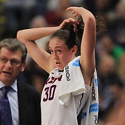 Breanna Stewart, UConn, on the bench as UConn coach Geno Auriemma, (left), directs the team during the UConn Vs DePaul, NCAA Women's College basketball game at Webster Bank Arena, Bridgeport, Connecticut, USA. 19th December 2014